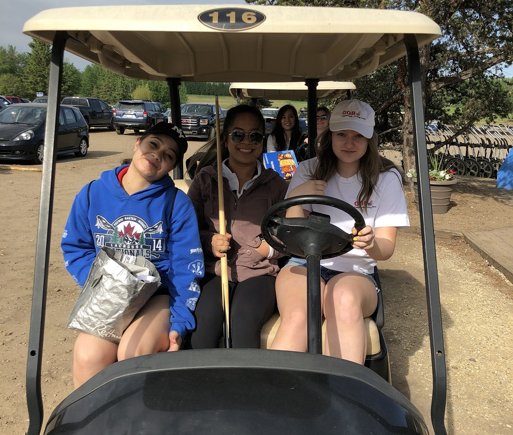 volunteers with GGB on a golf cart
